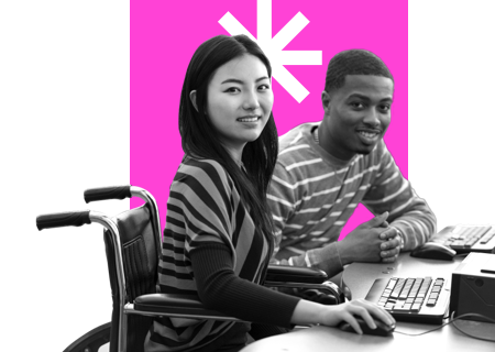 Two people working at a desk
